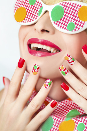 fashion girl style: Textured manicure with yellow and green dots and glasses.