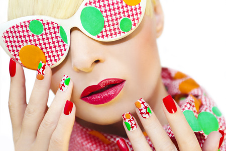 Textured manicure with yellow and green dots and glasses.