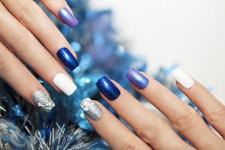 artificial nails: Christmas blue and silver with white nail Polish manicure.
