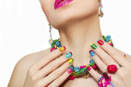 multicolored: Colorful French manicure and makeup on a girl with rhinestones and decorations on a white background.