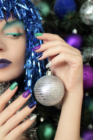 acryle: New Years makeup and multicolored French manicure with spangles.