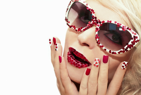 Holiday makeup and manicure with red hearts on my lips and nails on the blonde girl with sunglasses.