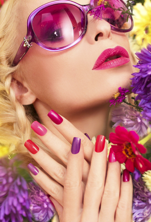 Summer manicure with purple asters for a beautiful girl with purple sunglasses.