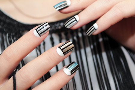 stripe: Gray striped nail design on female hand close up.