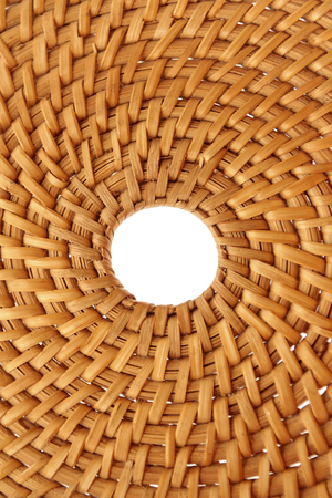 Woven hand-made product in the form of a circle closeup.