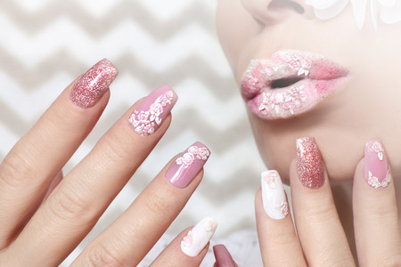 White pink pastel manicure and lip makeup with closeup rose stickers on girl.Nail art.