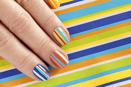 Multi-colored manicure Striped design.Nail art.