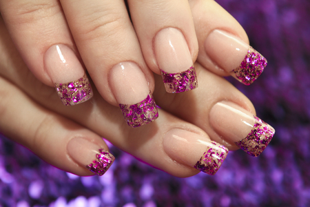 Brilliant french manicure with glitters on a purple background close-up File art. 写真素材
