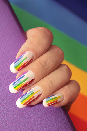 Rainbow design on long oval nails. Nail art. Multicolored French manicure. Imagens