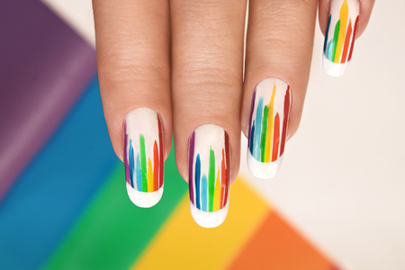 Rainbow design on long oval nails. Nail art. Multicolored French manicure. Stok Fotoğraf