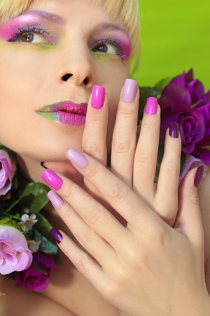 Multi-colored lilac pastel colors. Saturated make-up. Summer manicure. Imagens