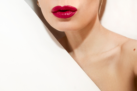 Glamorous fashion girl with red lips on white background.