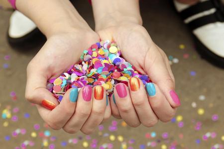 Colorful colorful manicure with confetti.Nail design.