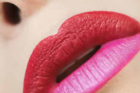 Multicolored trendy lipstick with pink and red lipstick closeup.