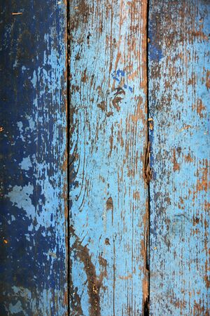 Background of old painted yellow-blue paint Board.Vintage background.
