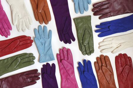 Collection of colorful bright fashionable gloves on a white background. Accessory for hands. Reklamní fotografie