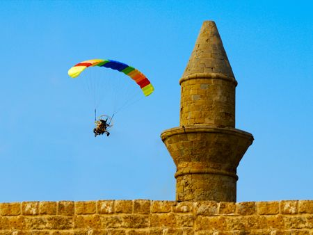 powered: A powered paraglider flying around an old minaret