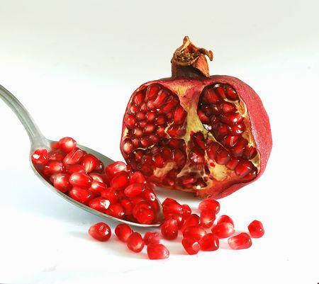 superfruit: Ripe pomegranate and spoon Stock Photo
