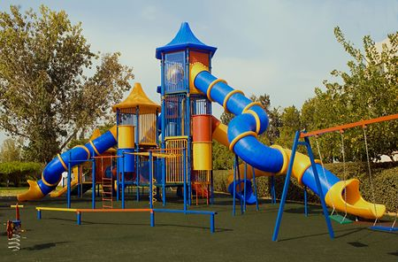 A colorful public playground in a garden Stock Photo - 3721650
