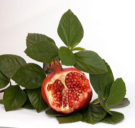 superfruit: Pomegranate isolated on white background