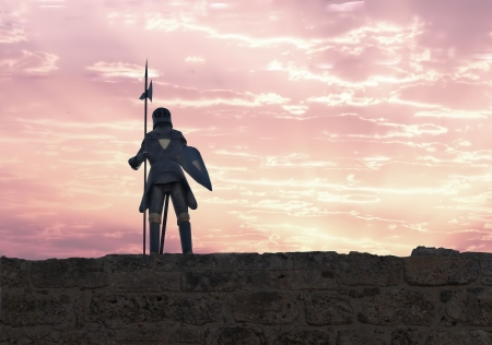 A knight with halberd in black armour Stock Photo