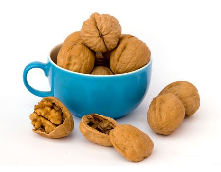fullness: Walnuts in cup on white background