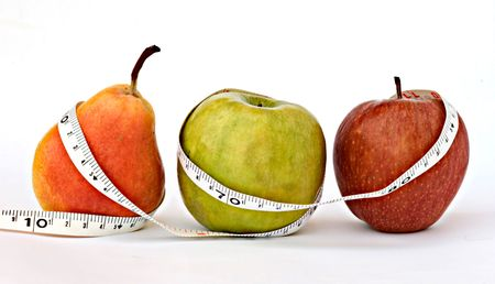 A pear and apples with measuring tape isolated on white background photo