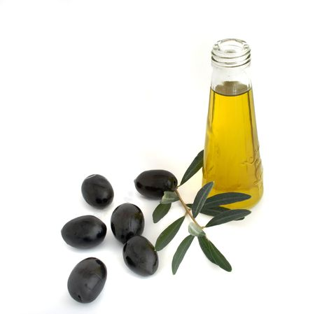 Bottle of olive oil and olive branch isolated on white background Stock Photo