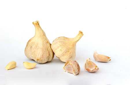 whie: Garlic bulbs and cloves isolated on whie background Stock Photo