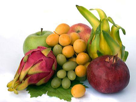 Bunch of fresh fruits isolated on white background photo