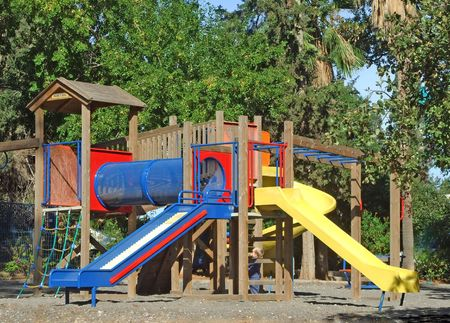A colorful public playground in a garden Stock Photo - 3934272