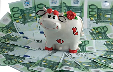 accumulation: A cow the money bank on money pasture