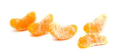 vitamines: Tangerine segments islolated on white background Stock Photo