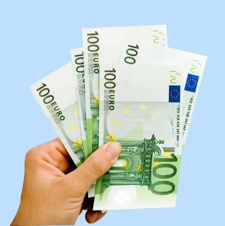 creditor: Hand with euro isolated on background