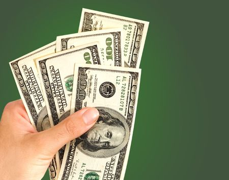 payer: Hand with dollars isolated on green background