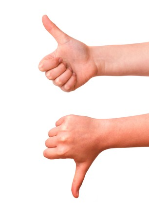 hands showing thumb up and thumb down photo