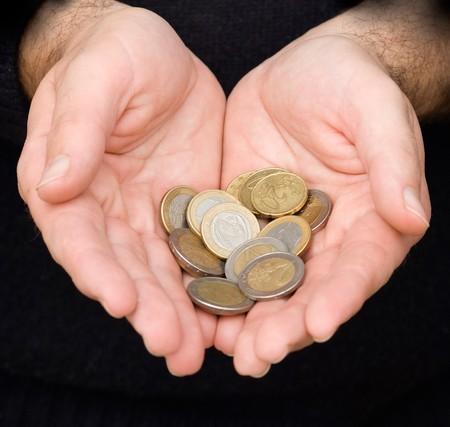 bimetallic: Palms with euro coins