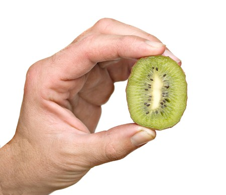 national fruit of china: hand holding a section of kiwi fruit