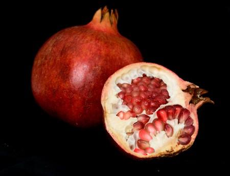 superfruit: Pomegranate isolated on black background Stock Photo