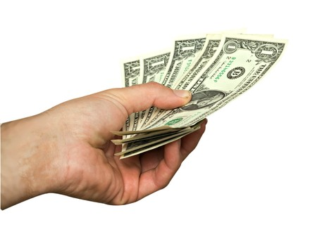 payer: Hand with dollars isolated on background Stock Photo