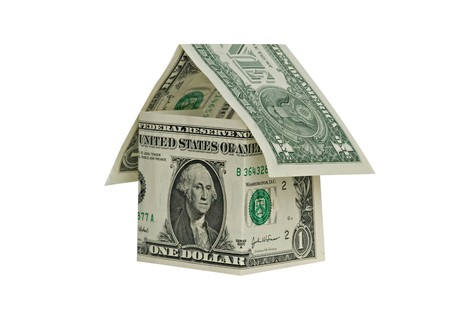 housing crisis: Money home isolated on white background Stock Photo