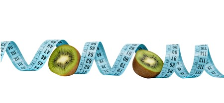 national fruit of china: Sections of kiwi fruit with measuring tape