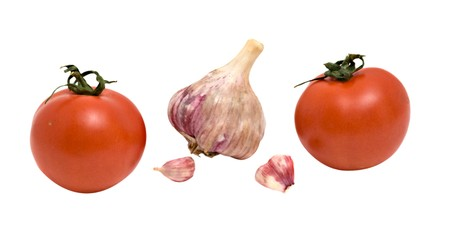 alliaceae: Two tomatoes and garlic isolated on white background