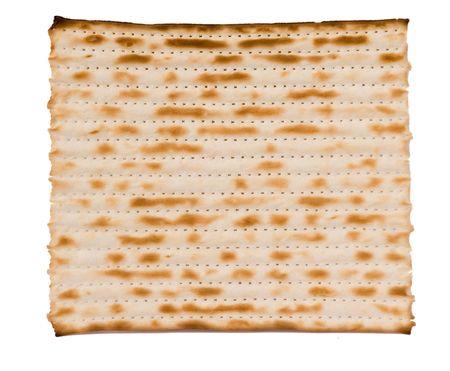 Close up of square matza isolated on white background photo