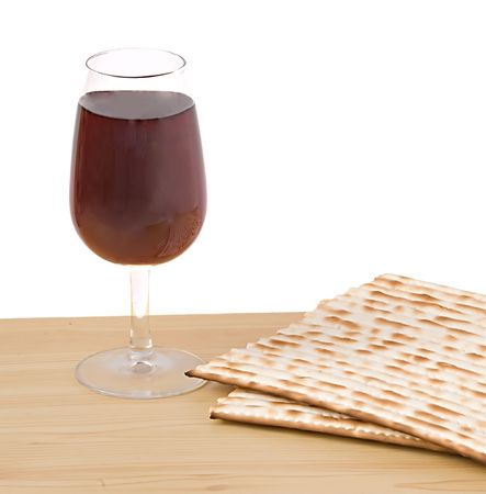 Close up of matza and goblet with red wine  photo