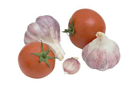 alliaceae: Tomatoes and garlic isolated on white bakground