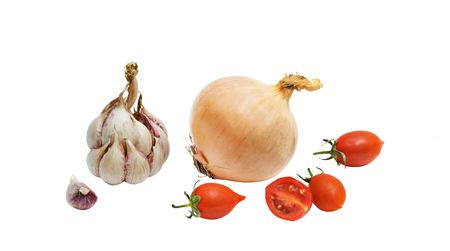 alliaceae: Tomatoes, onion, and garlic isolated on white bakground