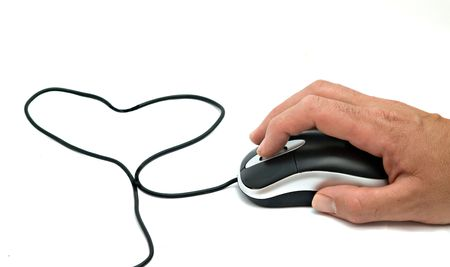 Mouse with cable folded to a heart-like figure photo