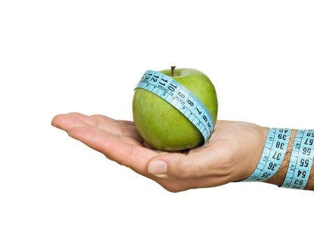 Hand with apple and measuring tape photo