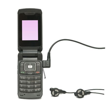 Close up of mobile telephone with headset photo
